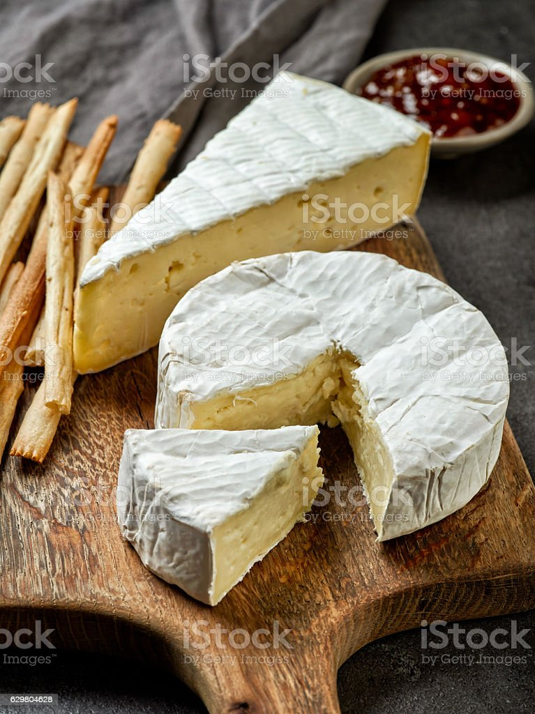 camembert cheese on wooden cutting board - Photo