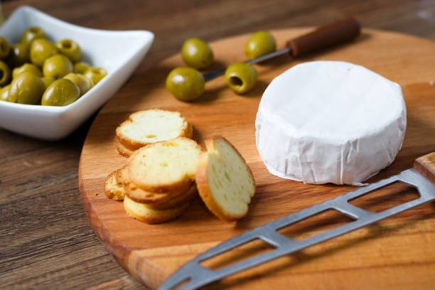 Camembert cheese with bread chips stock photo