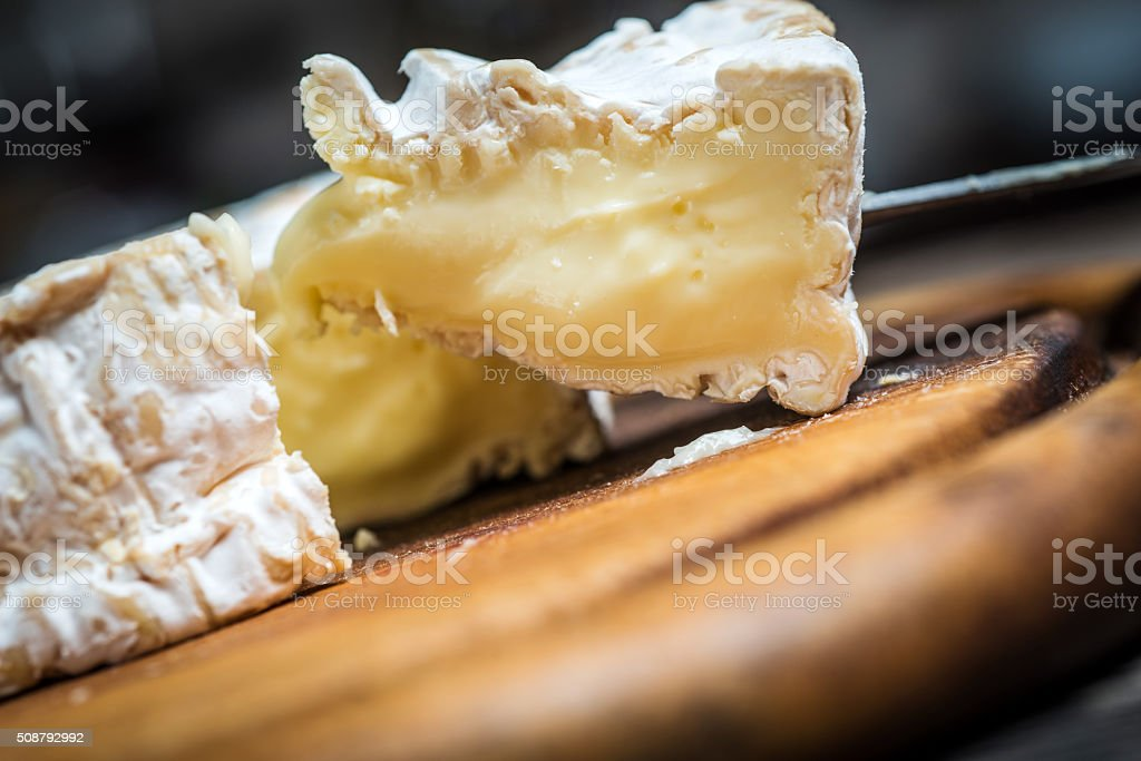 Camembert cheese with knife stock photo