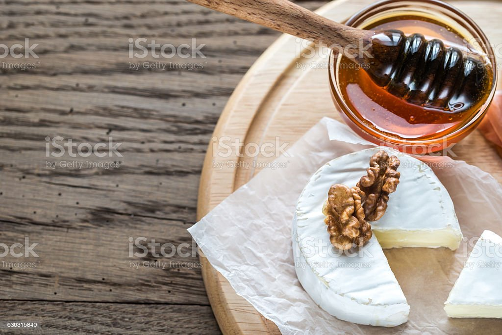 Camembert cheese with walnuts and honey stock photo