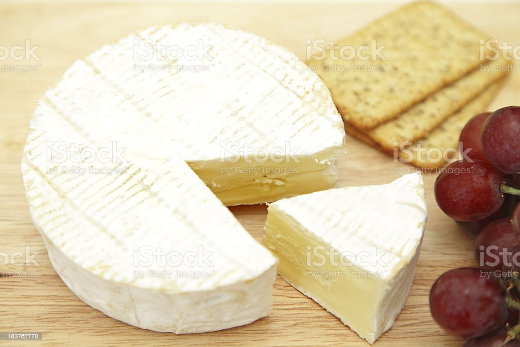 camembert cheese,crackers and grapes royalty-free stock photo