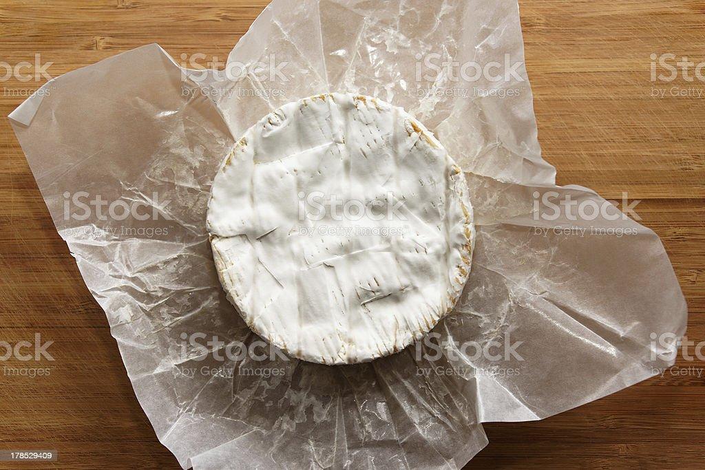 Camembert on a wooden board royalty-free stock photo