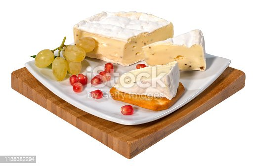 Camembert or brie cheese with truffle on a serving board,isolated on white with clipping path.