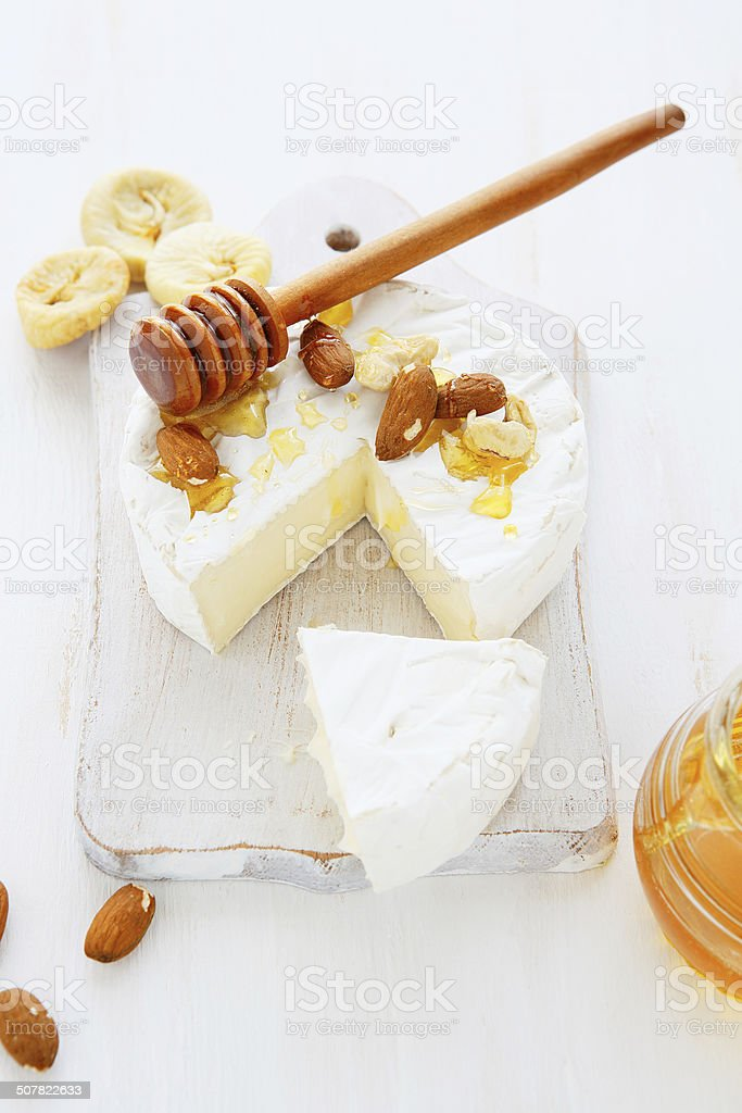 Camembert with nuts and honey stock photo