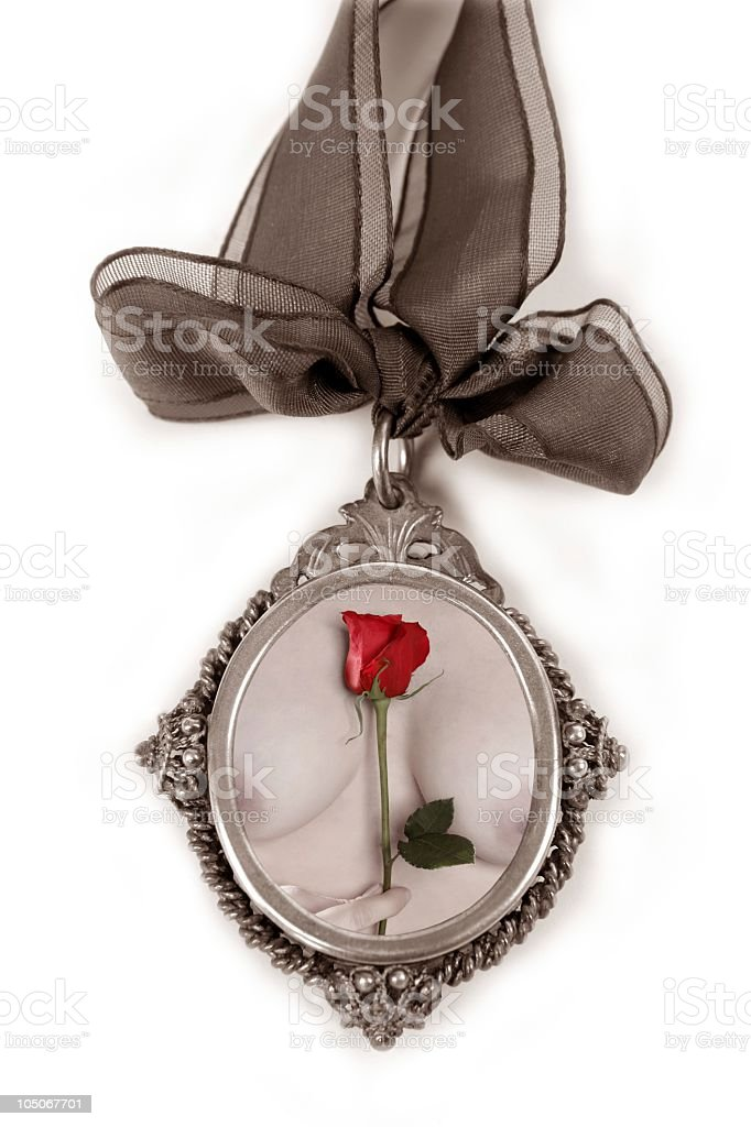 Cameo silver locket with woman breast and red rose stock photo
