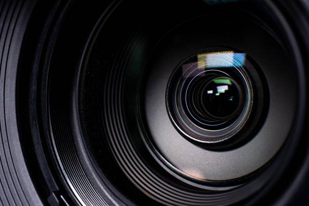kamera und objektiv zoom, nahaufnahme - fotografische themen stock-fotos und bilder