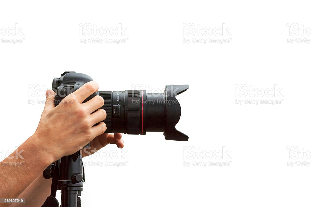 DSLR camera and male photograper hands, white background, copy space stock photo