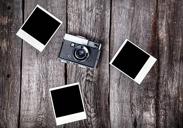 Camera and polaroid photos stock photo