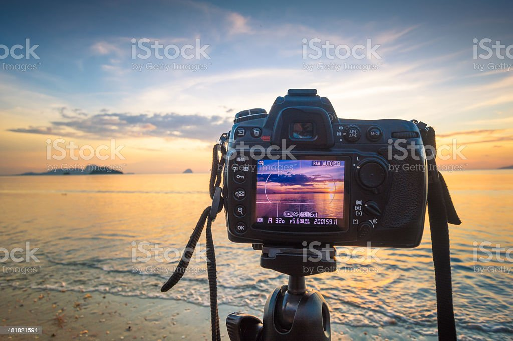 DSLR camera at  the beach scenery stock photo