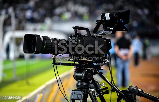 TV camera at the stadium during football match