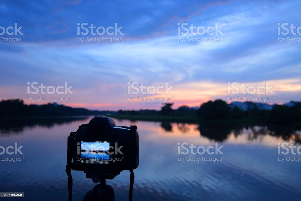 Camera back stage with river landscape and sunset. stock photo