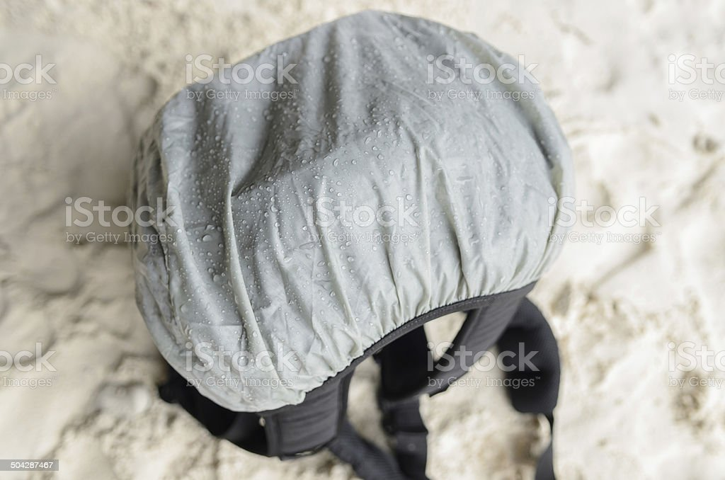 camera bag with raincoat sheet stock photo