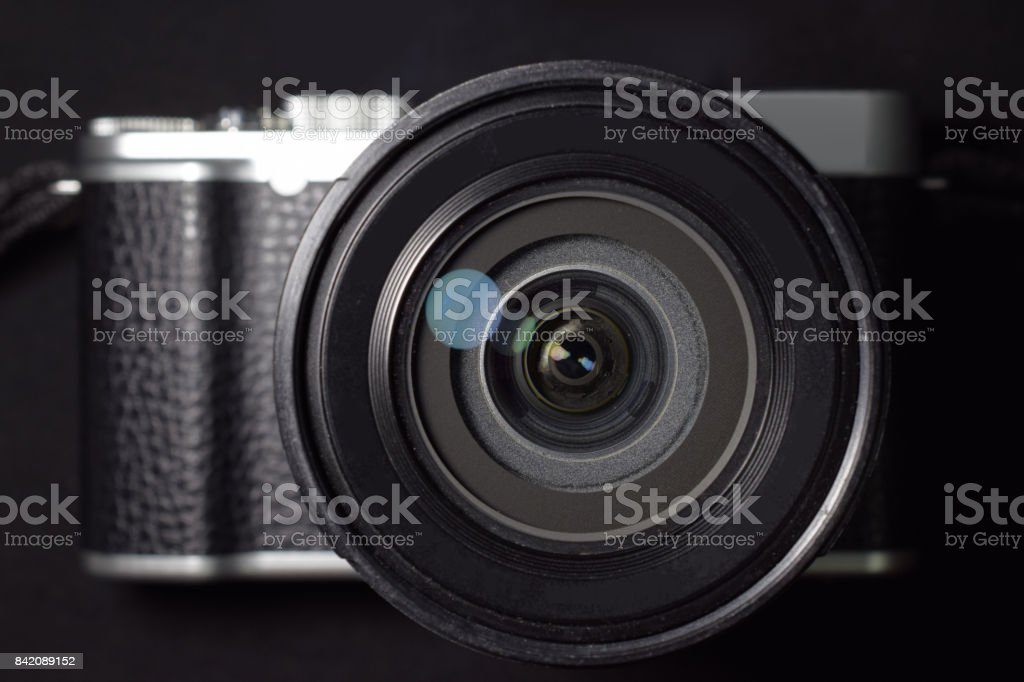 Camera body and lens on black background. stock photo