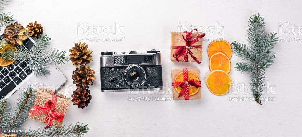 Camera Christmas wooden background. New Year's holiday. Christmas motive. On a wooden surface. Top view. Free space for your text. stock photo