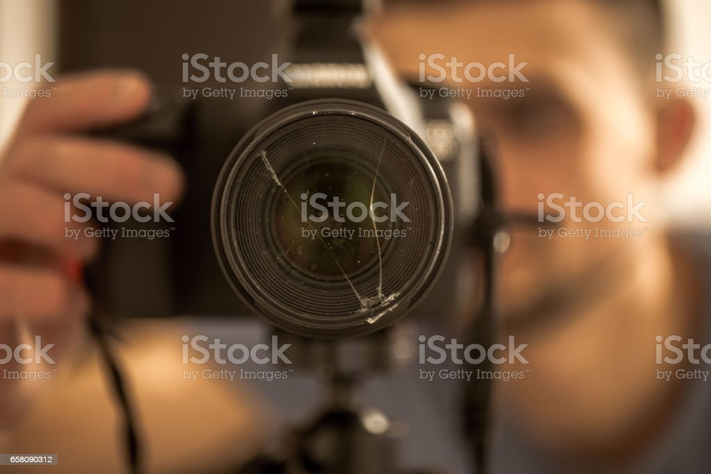 camera close up with broken glass on the lens stock photo