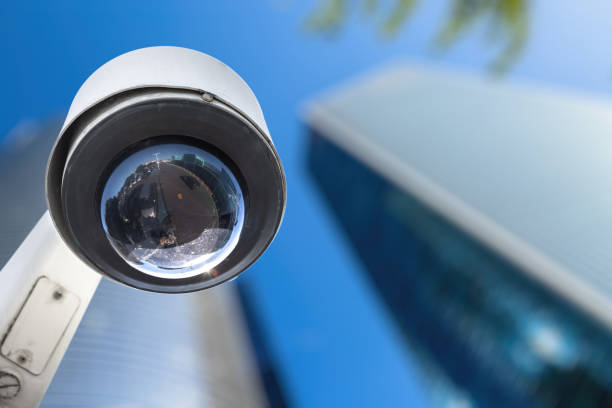 CCTV camera concept with business buildings in the background stock photo