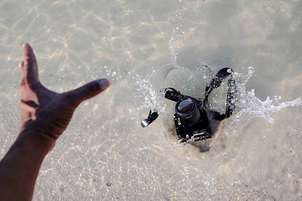 Camera fall to the sea water. stock photo
