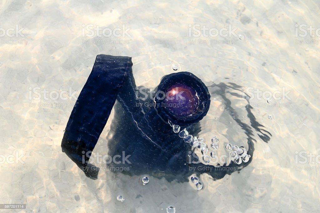 Camera fall to the sea water stock photo