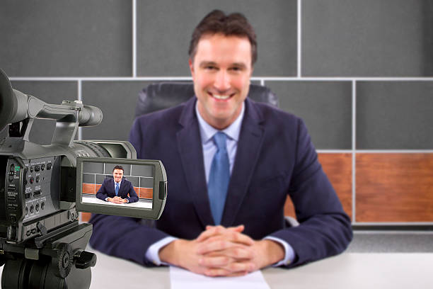 Camera Filming a Reporter or Anchorman in a Studio stock photo