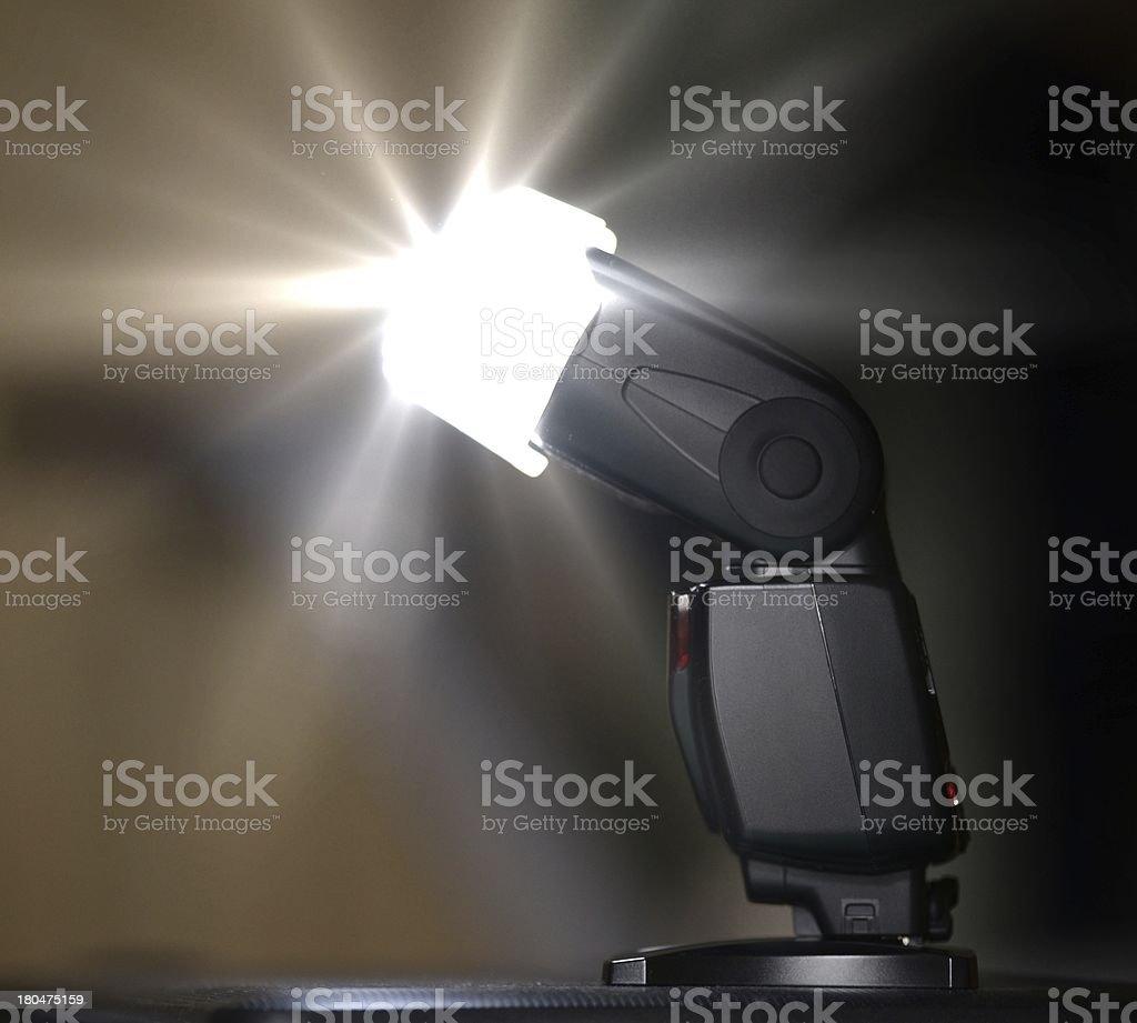 Camera flash or speedlite firing. stock photo