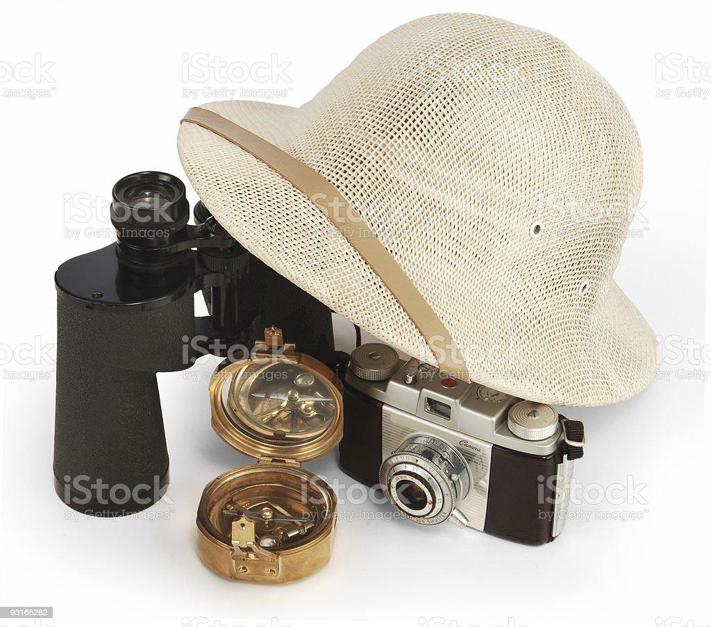 Camera, hat, binoculars and compass stock photo