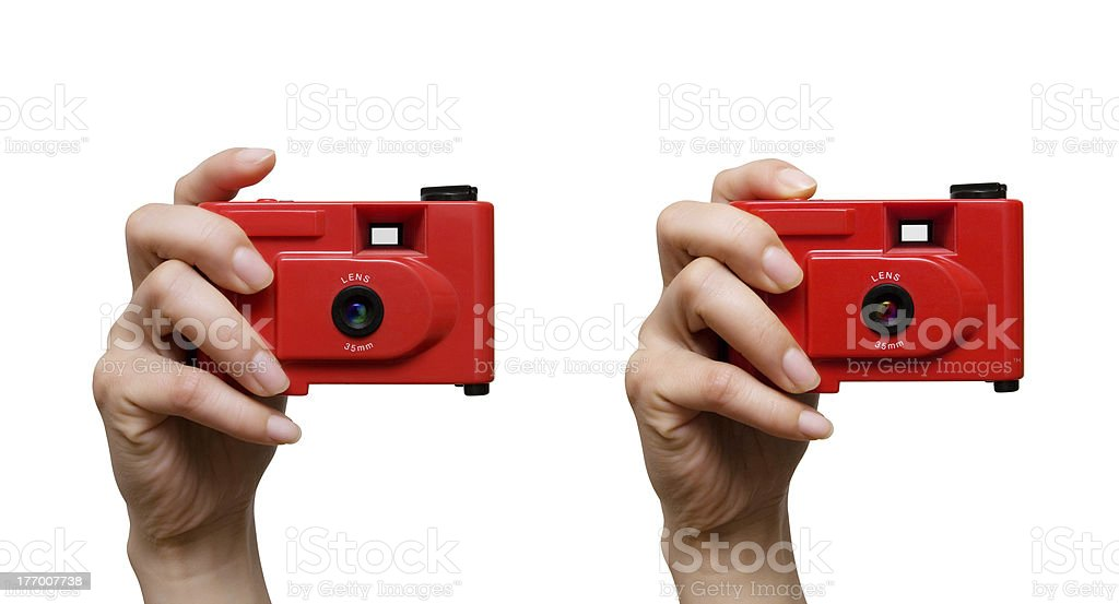 Camera in a hand stock photo