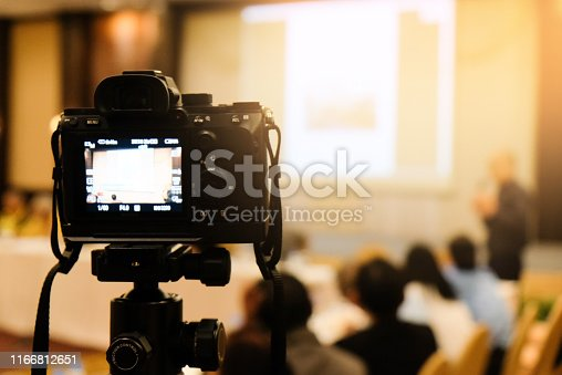 camera in business conference room recording participants and speaker echnology transformation of mirrorless camera