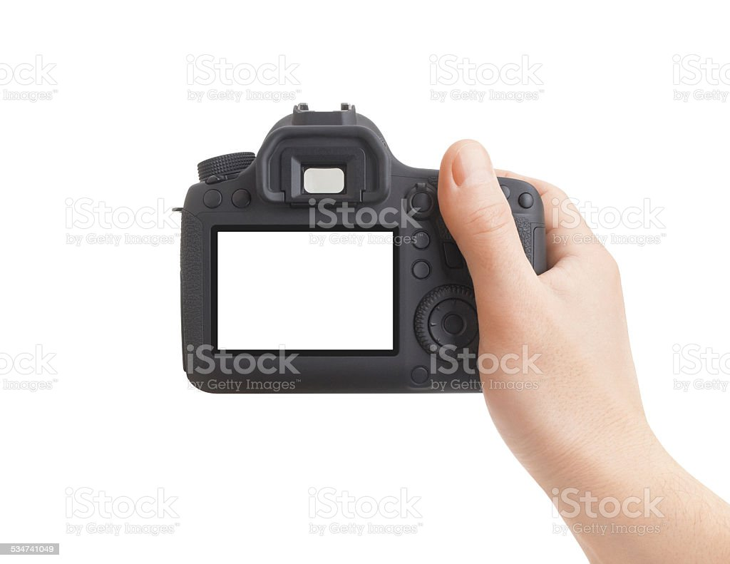 Camera in hand on white background stock photo