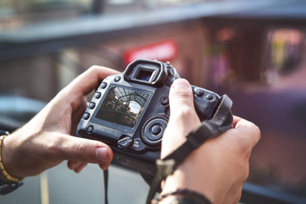 camera in hand, street photography, live view - digital viewfinder stock photos and pictures