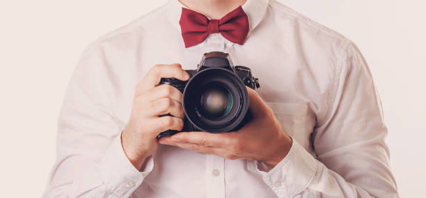 camera in the hands of the photographer, close-up stock photo