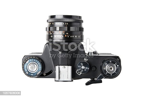 Camera isolated. Top view on a old film mirror SLR camera isolated on a white background. Concept vintage and retro.