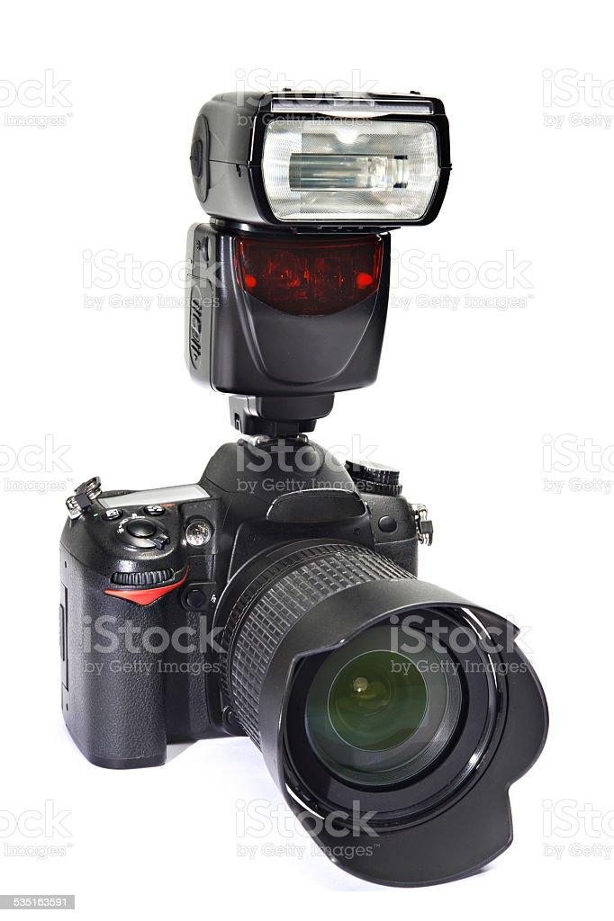 DSLR camera, lens and flash stock photo