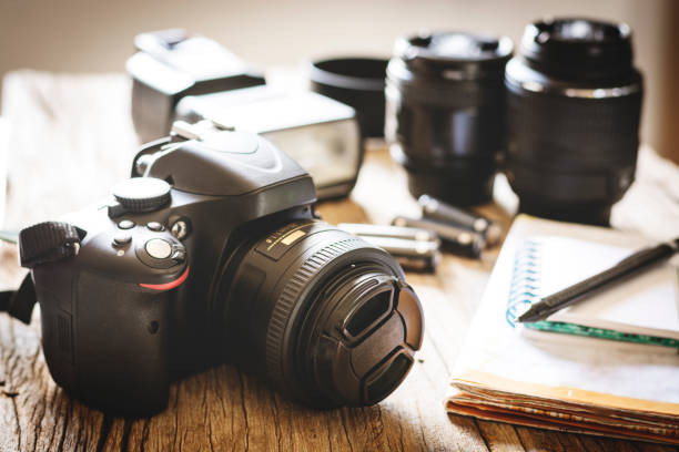 camera, lens and flash. - camera photographic equipment stock pictures, royalty-free photos & images