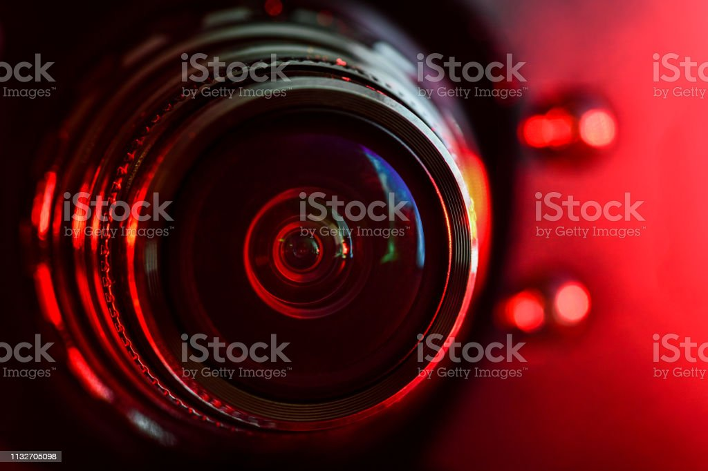 Camera lens and red backlight . Horizontal photography - Royalty-free Alarm Stock Photo