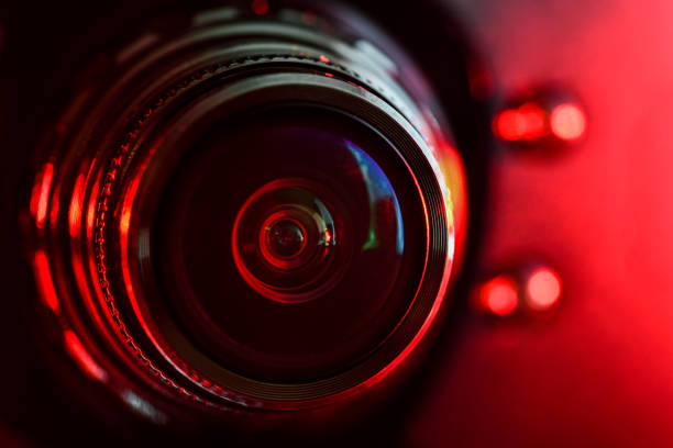 camera lens and red backlight . horizontal photography - webcam stock pictures, royalty-free photos & images