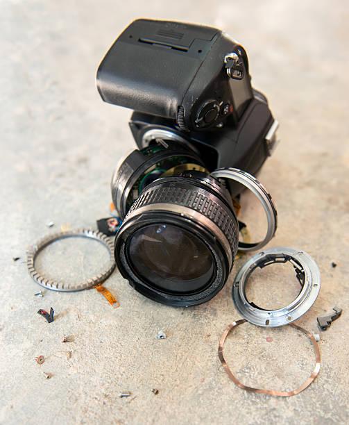 camera lens broken stock photo