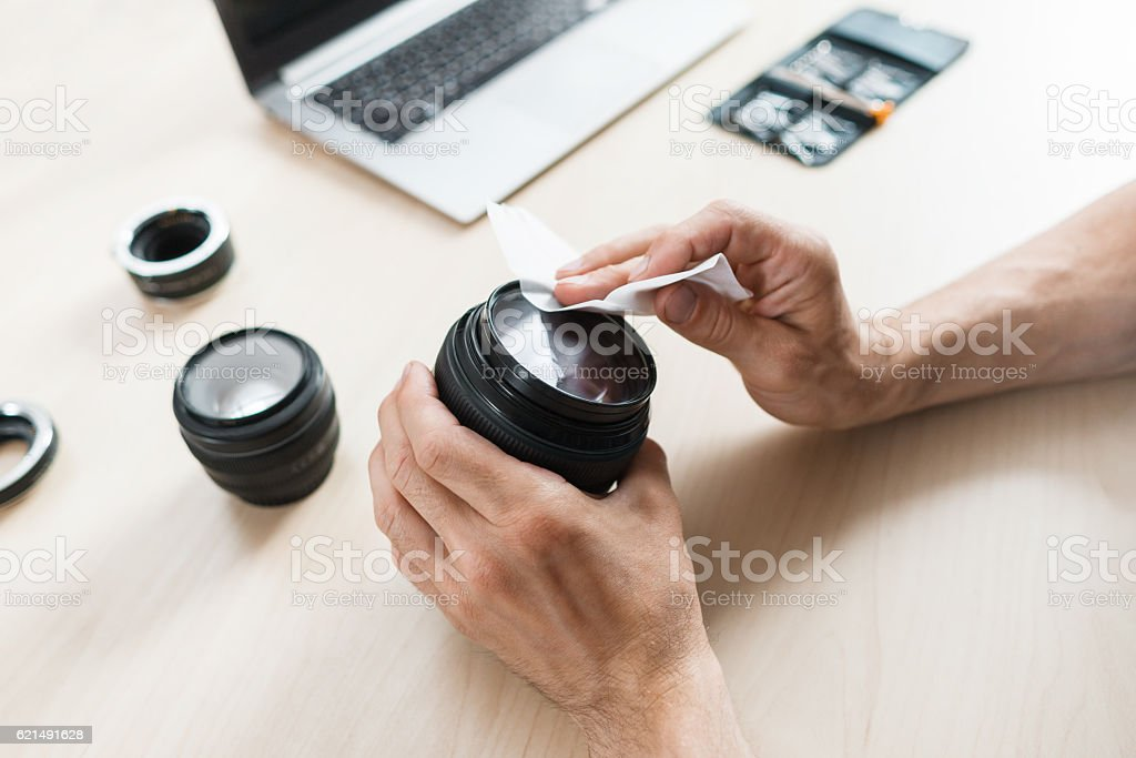 Camera lens cleaning with wet wipe, close-up Lizenzfreies stock-foto