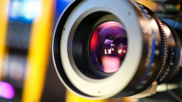 camera lens during media production event close up on media production video cameras in a recording studio, all logos or trademark signs and elements were cloned away or blurred out. performing arts event stock pictures, royalty-free photos & images