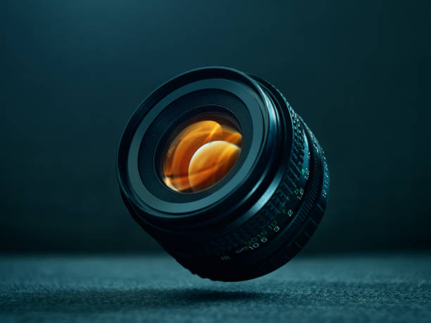 dslr camera lens floating in the air - aperture stock pictures, royalty-free photos & images
