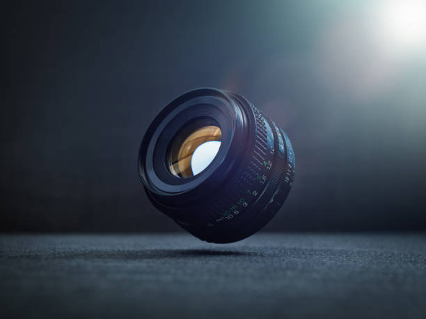DSLR camera lens floating in the air stock photo