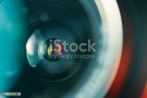 istock Camera lens in colorful light 1166424116