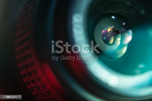 istock Camera lens in colorful light 1166424117