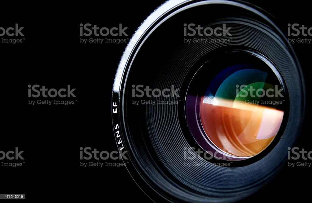 Camera lens isolated on black Camera lens isolated on black.  Black Background Stock Photo