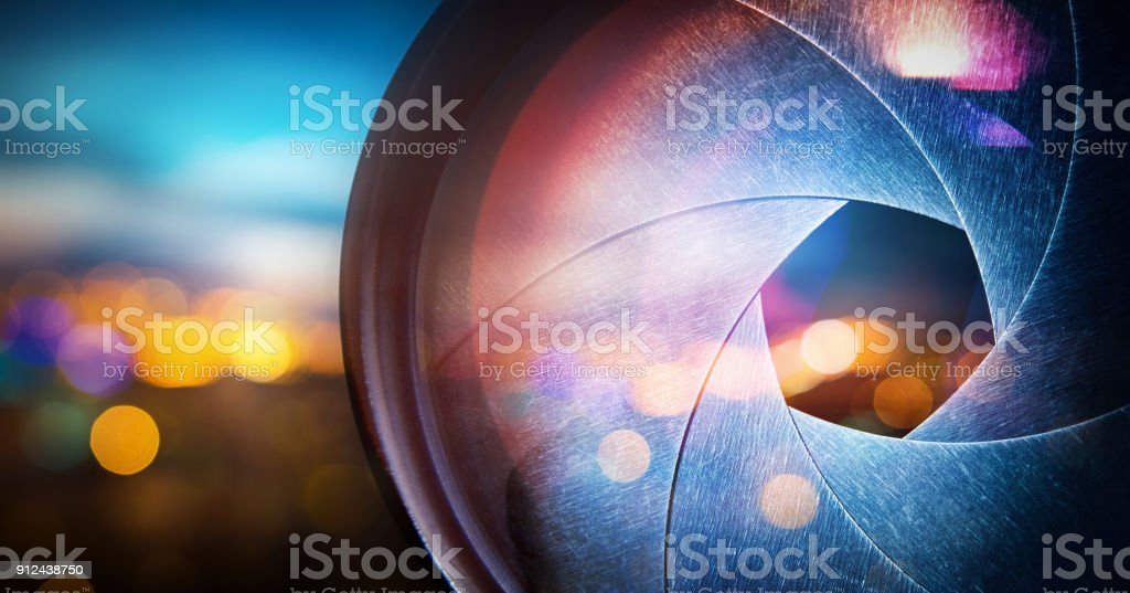 Camera lens on blur night city stock photo