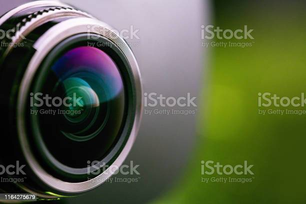 Camera lens with green backlight side view of the lens of camera on picture id1164275679?b=1&k=6&m=1164275679&s=612x612&h=5xvmxojmxphgrid5nzwq6qmlmpkz2ptfggxmkq42ekk=