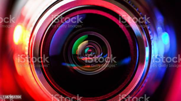 Photo of Camera lens with red and blue backlight. Macro photography lenses. Horizontal photography