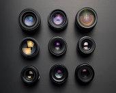 SLR camera lenses on gray background