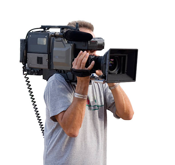 Camera man closeup with video camera stock photo