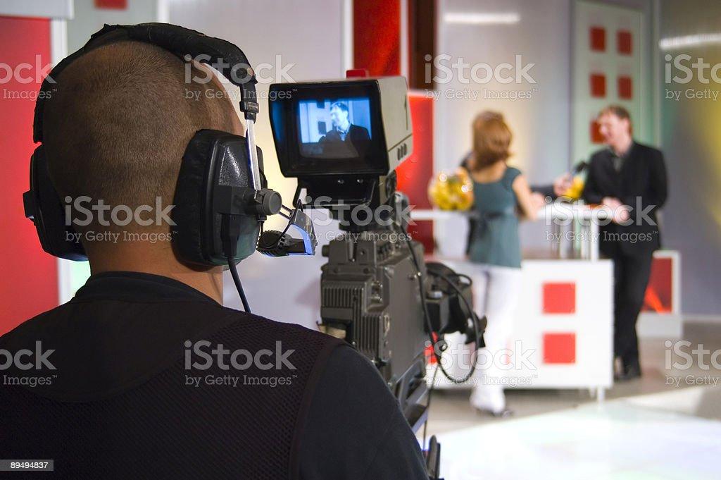 Camera man filming in TV studio royalty-free stock photo
