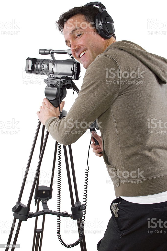 Camera Man Wearing Headphones with a Camera and Tripod royalty-free stock photo